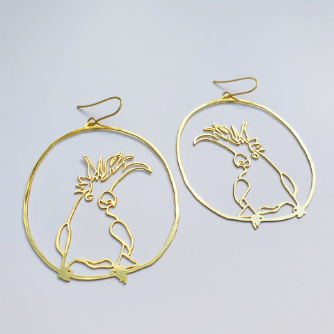 cockatoo dangles in gold