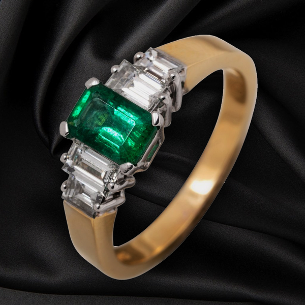 18CT EMERALD AND DIAMOND RING