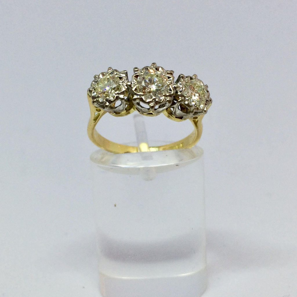 PLATINUM AND 18CT YELLOW GOLD THREE STONE DIAMOND RING