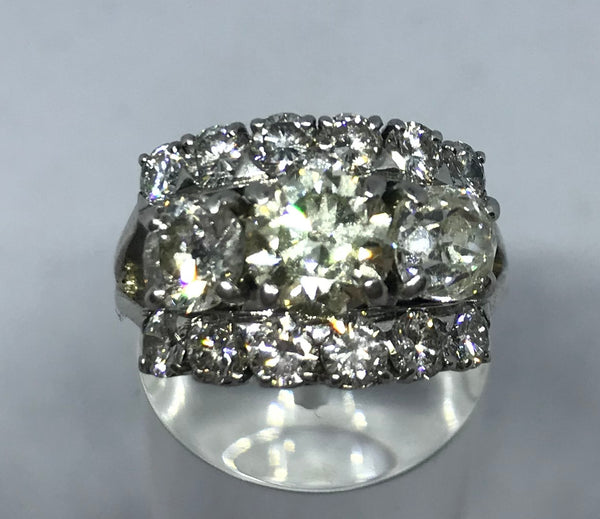 Vintage veri-cut three stone diamond ring