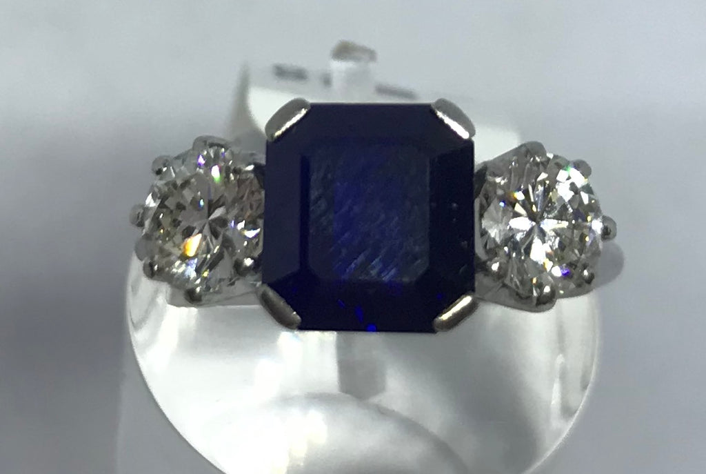 18ct white gold sapphire and diamond three stone ring.