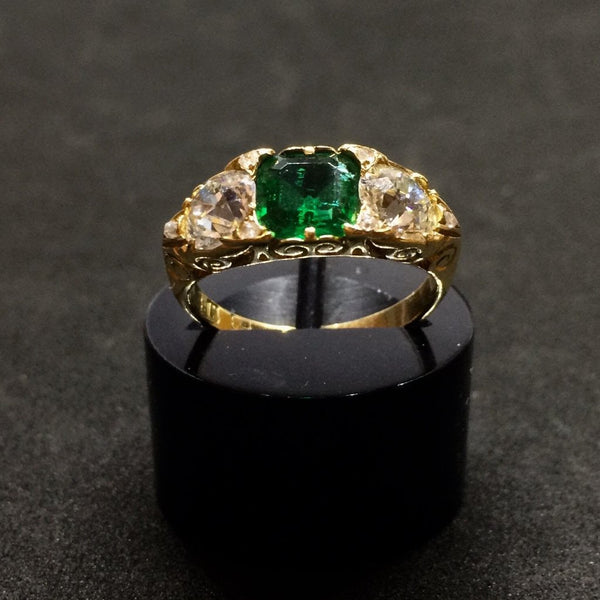 18CT YELLOW GOLD MUZO EMERALD AND DIAMOND RING