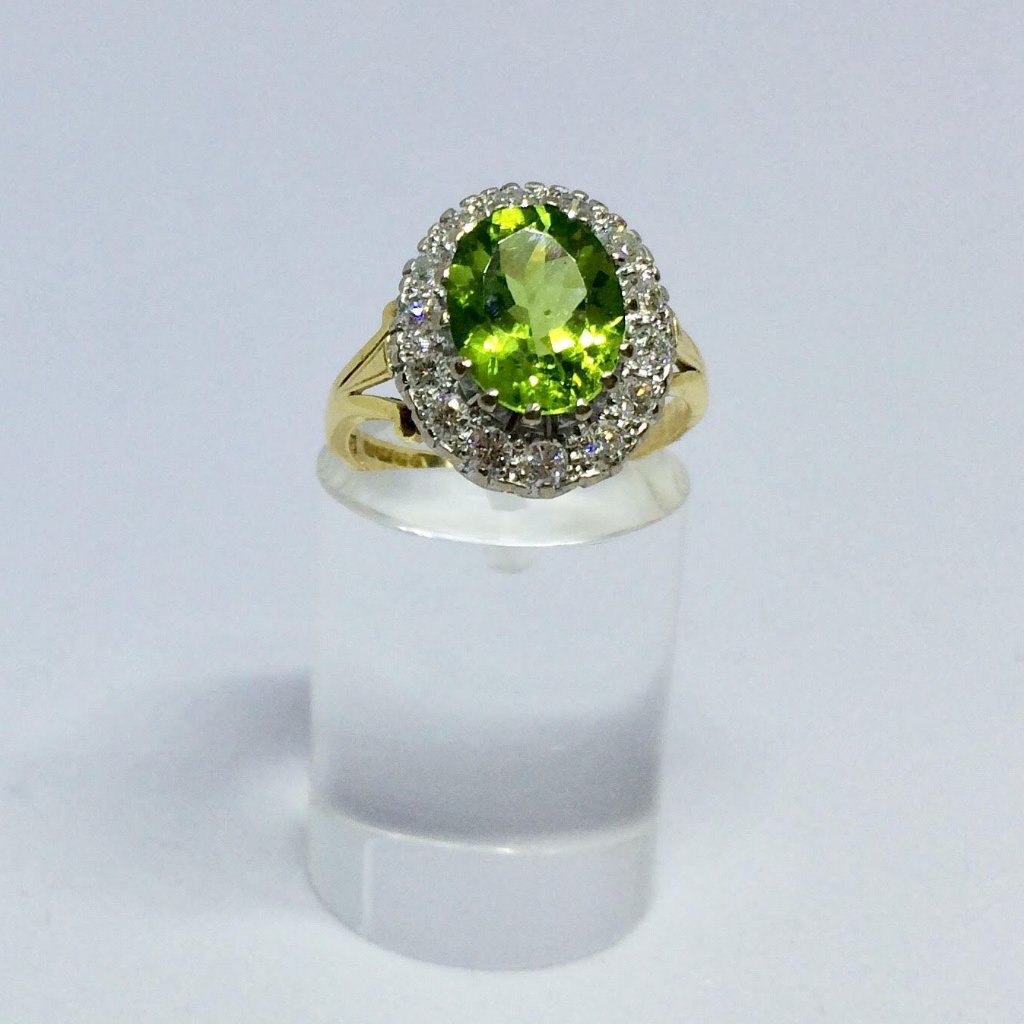 18CT YELLOW GOLD PERIDOT DIAMOND HALO RING