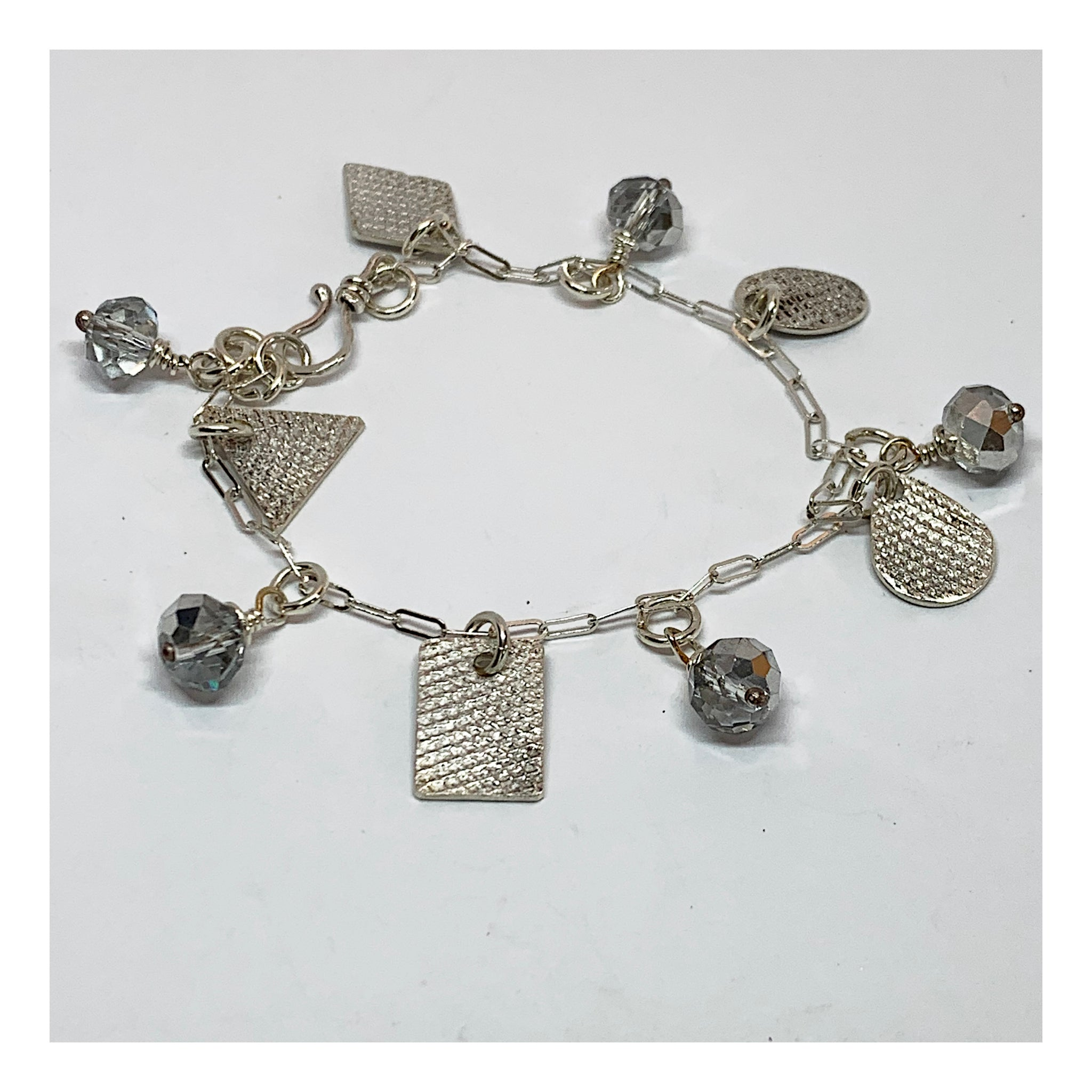 Dainty and Elegant Multiple Charms Bracelet in Sterling Silver