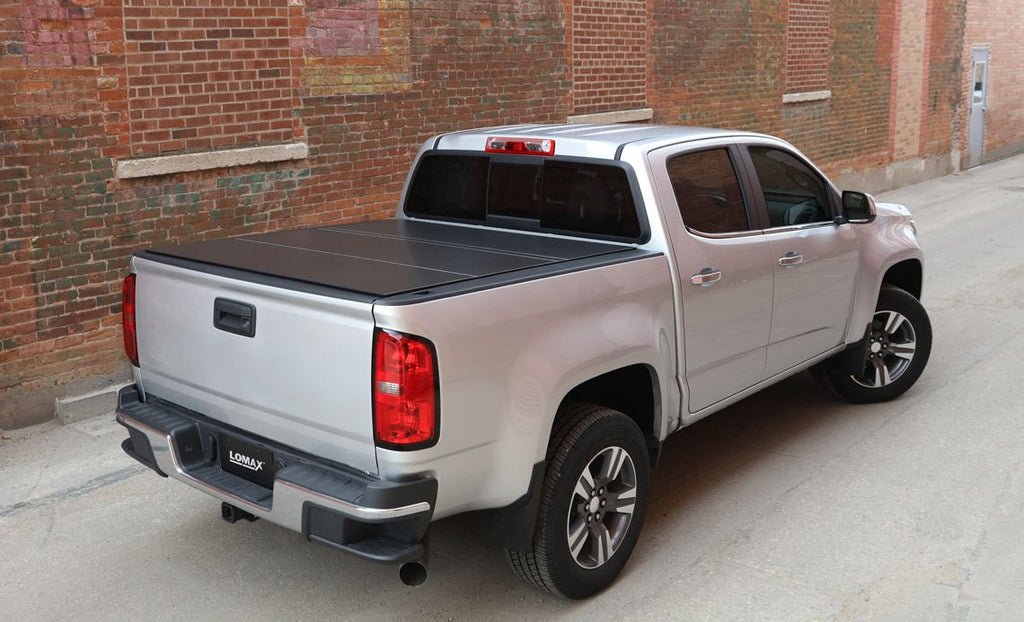 Access LOMAX 2009-2017 Dodge Ram 1500 5ft 7in Short Bed Tri-Fold Tonneau Cover (Without RamBox Cargo Management System)