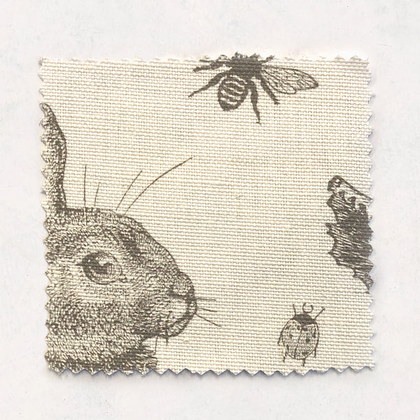 Rabbit & Cabbage Grey Fabric on Oyster Linen