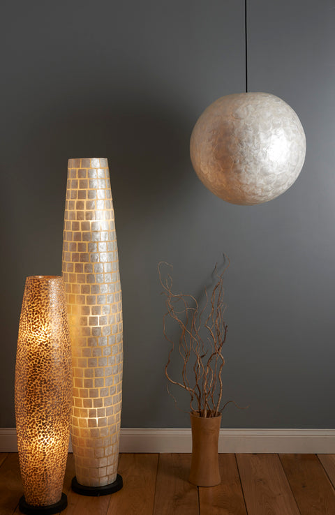 Unique lighting design - tall lamps and large lampshade all handmade from mother of pearl. Lighting by Collectiviste.