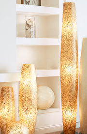 Natural white and gold floor lamps. Handcrafted from capiz shells by by Collectiviste. Unique & Unusual decorative lighting.