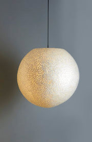 Unique globe lamp shade. Handcrafted from white mother of pearl. Elara by Collectiviste