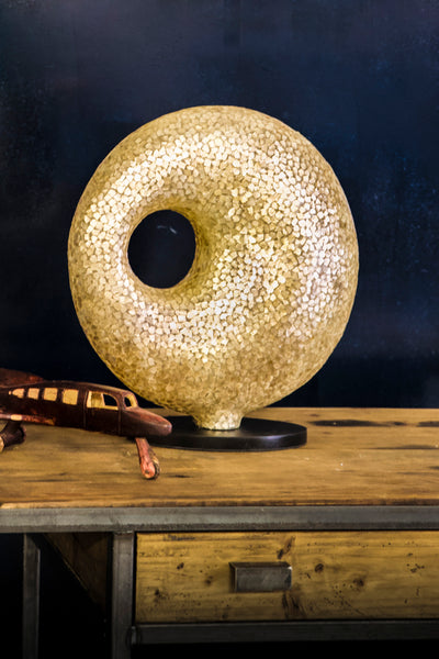 Gold sculpture lamp in unique torus shape. Handcrafted with gold shells by Collectiviste.