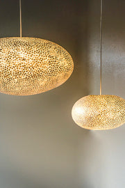 Stunning mother of pearl pendant lighting display. Elara ceiling lamp shades by Collectiviste.