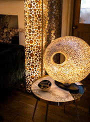 Gold table lamp in unique torus shape. Handcrafted with gold shells by Collectiviste.