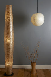 Shell lighting by Collectiviste. Tall gold floor lamp and mother of pearl ceiling pendant.