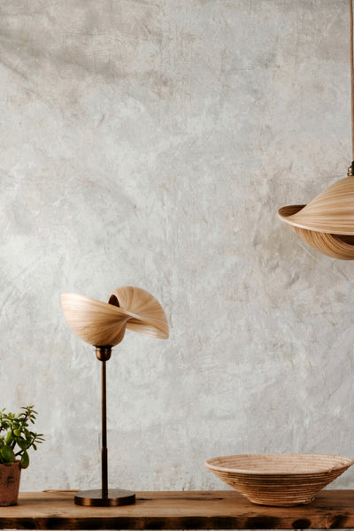 Bamboo table lamp with bronze lamp stand. Natural interiors.