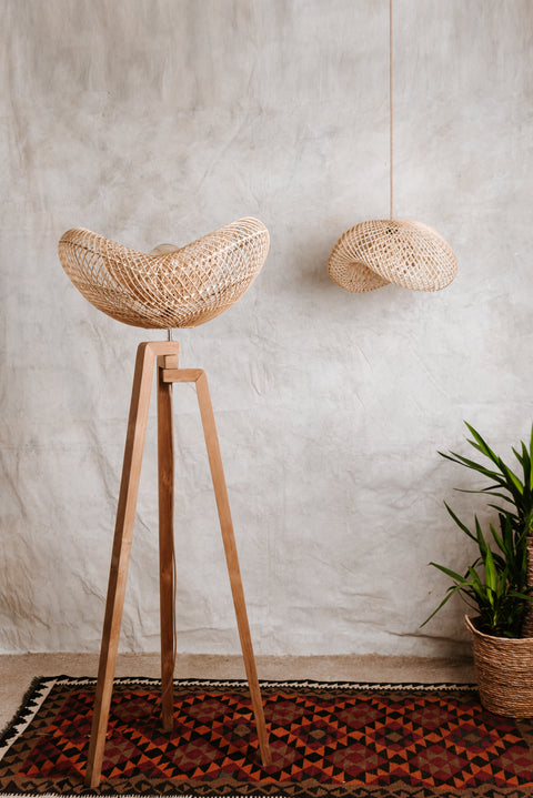 Designer rattan lampshade and tripod floor lamp carved from teak wood. Portobello rattan collection by Collectiviste.