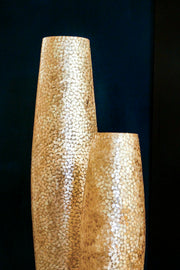 Callisto floor lamps in the dark by Collectiviste. Handcrafted with gold shells.