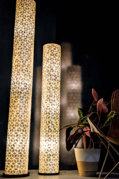 Tall floor lamp composed of mother of pearl shells in geometric diamond pattern. Contemporary Design. Light On