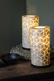 Pair of white oyster shell table lamps in geometric diamond design. Cube design. Switched On