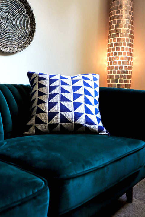 Luxury Cushion in bright blue, handwoven in Colombia. Triangulos by Collectiviste home decor.