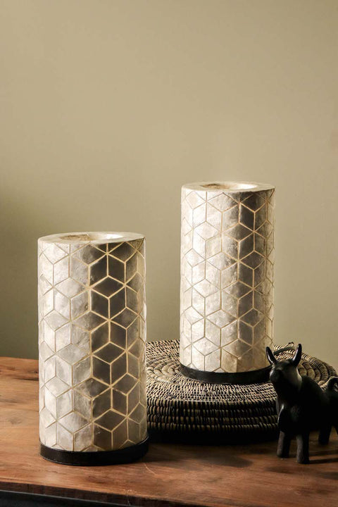 Pair of white oyster shell table lamps in geometric diamond design. Cube design. Light Off