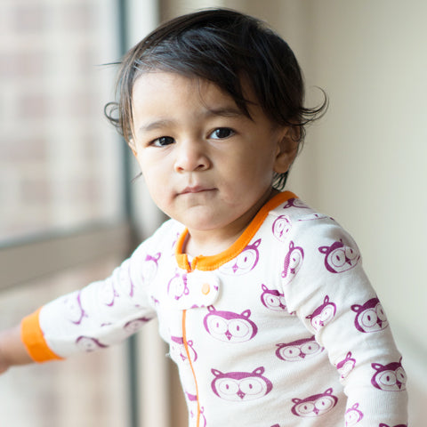 mirasa footed onesies are organic cotton + gender neutral with grippy feet and a zipper to make changing easy and play safe.