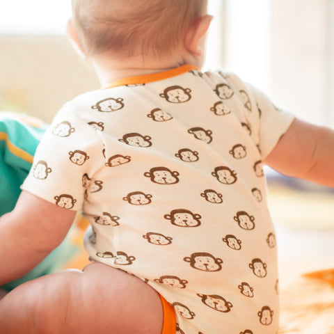 mirasa onesies are gender neutral- organic cotton- and super cute! They come in several sizes and prints. All mirasa product is made using fairtrade practices.