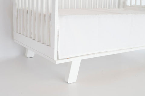 white crib skirt