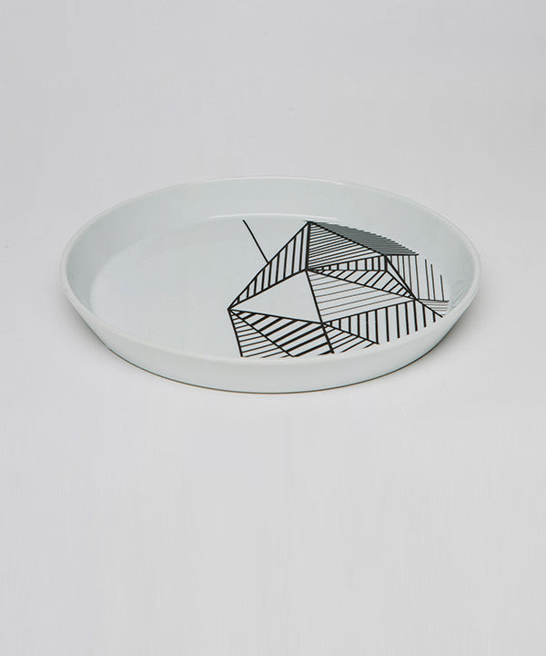 Side view of white and black geometric porcelain plate for pyropet candles