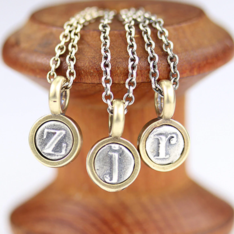 sterling silver with bronze border lower case letters