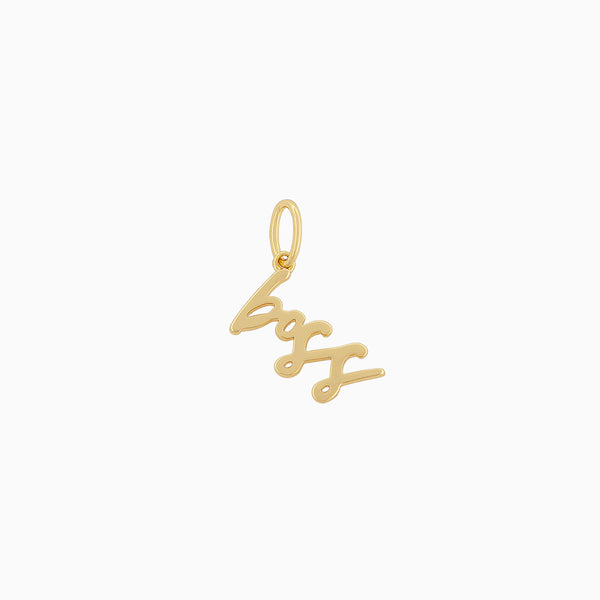 "Charm that says ""boss"" with 14k gold plating"