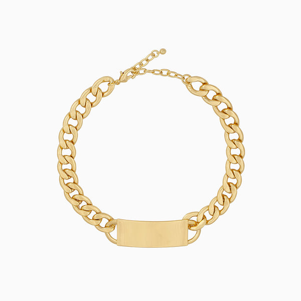 Thick curb chain choker plated in 14k gold with a solid plate at its center