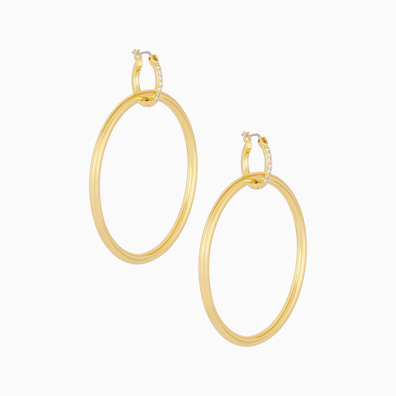 A 14k gold-plated hoop dangling from a smaller huggie lined with cubic zirconia