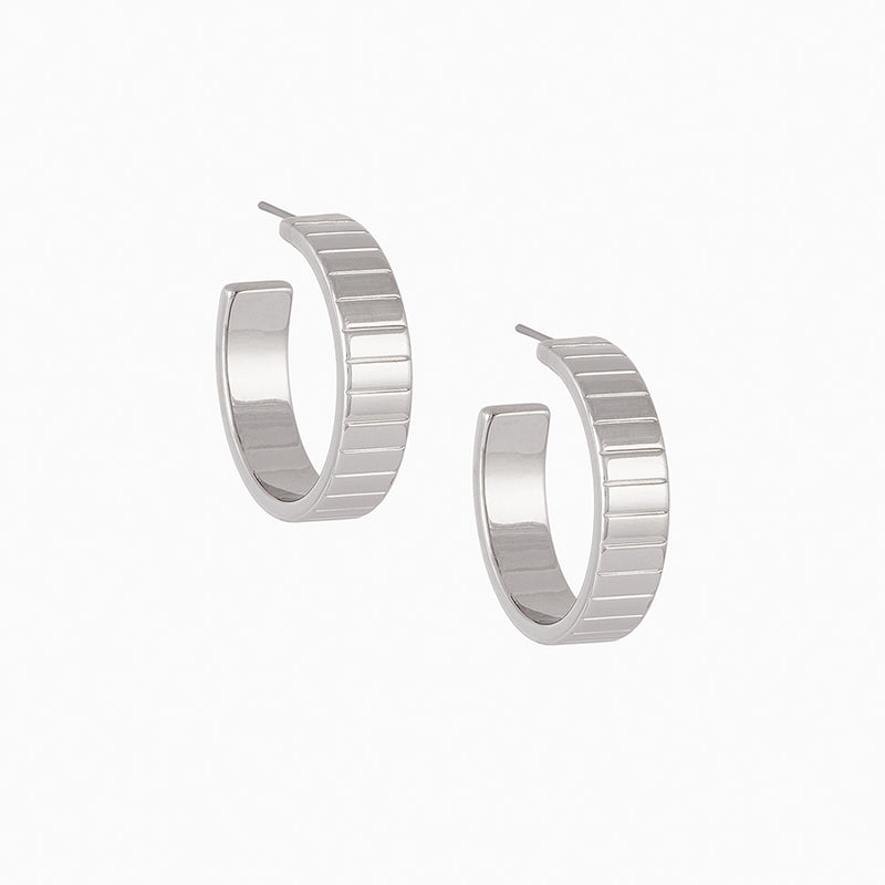 Rhodium-plated hoop earring line with embedded horizontal lines for texture