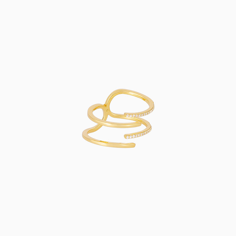 A 14k gold-plated ring with 4 alternating bands, created with cubic zirconia