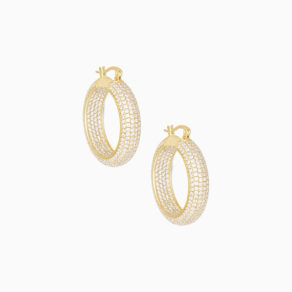 A thick hoop created with 14k gold plating and encrusted with cubic zirconia