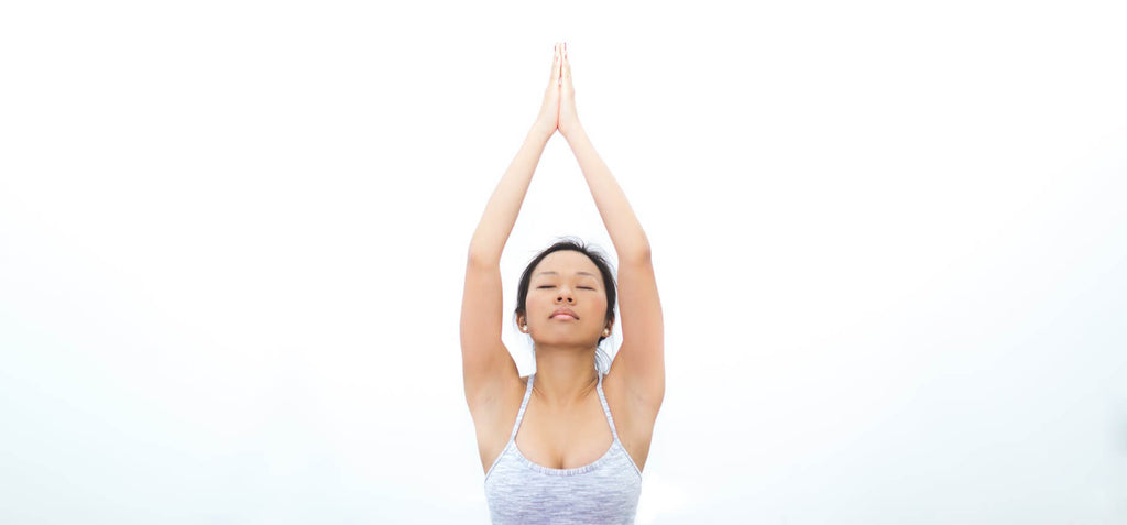 woman tree pose yoga