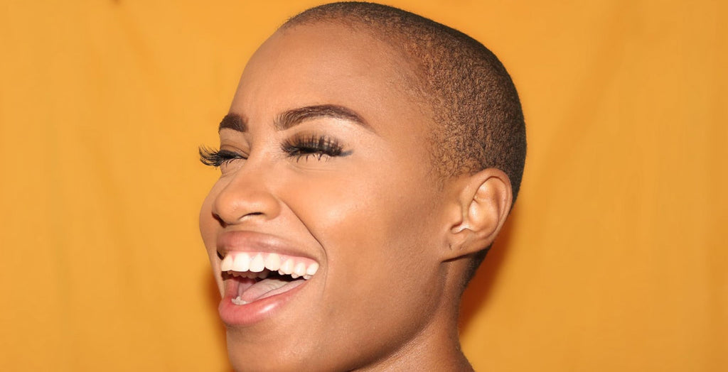 shaved head happy woman laughing