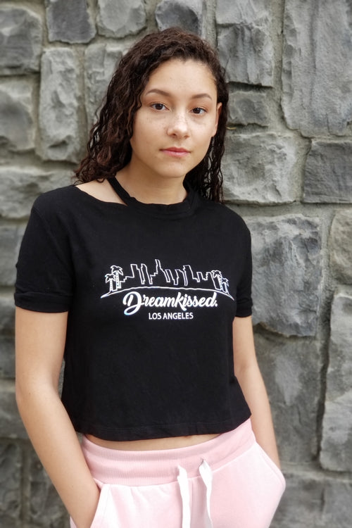 This black super soft t shirt features a trendy cut out, rolled sleeves  and a Dreamkissed. hologram.