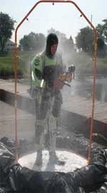 Drysuit diver in portable decon waste pool