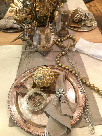 silver charger and gold ornament tabletop