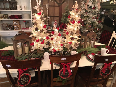 table setting with lighted trees and red birds