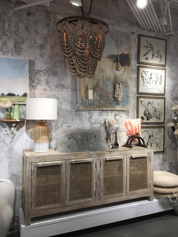 pretty display at market with sideboard and pillows and chandelier