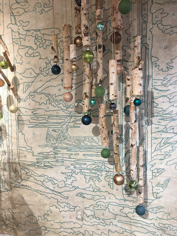 birch garland hanging in front of paint by number wallpaper