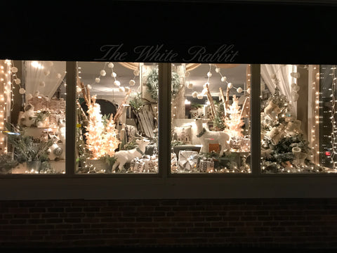 snowy christmas window display at night