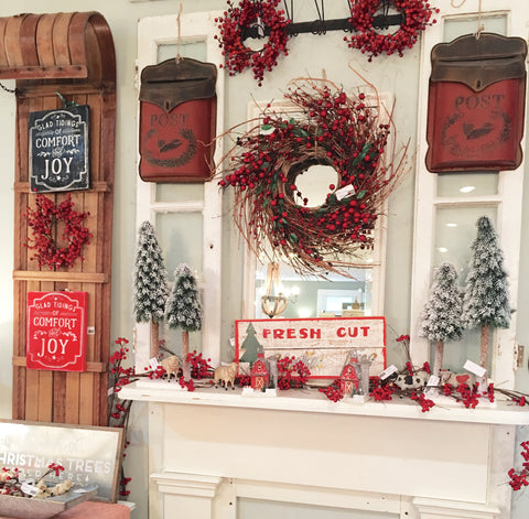 farmhouse mantel with red berries, trees sign and vintage windows
