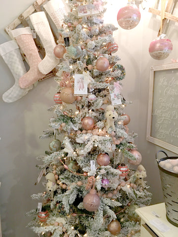 pastel flocked Christmas tree with pink, green, white stockings