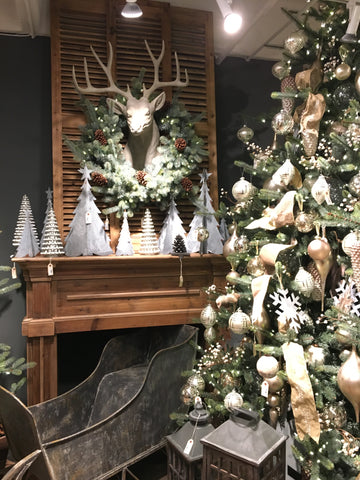 christmas tree and deer head with wreath in christmas showroom