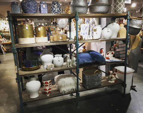 huge shelf filled with pillows and pottery