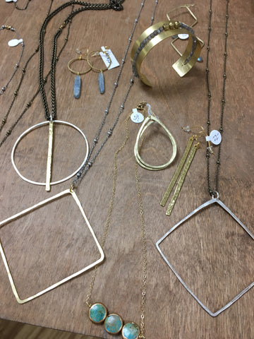 selection of mary garrett jewelry pieces on a table