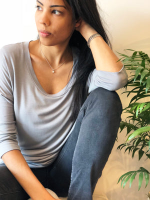 woman wears light grey nursing top with 34 length sleeves perfect for work. Designed by Milk Top London